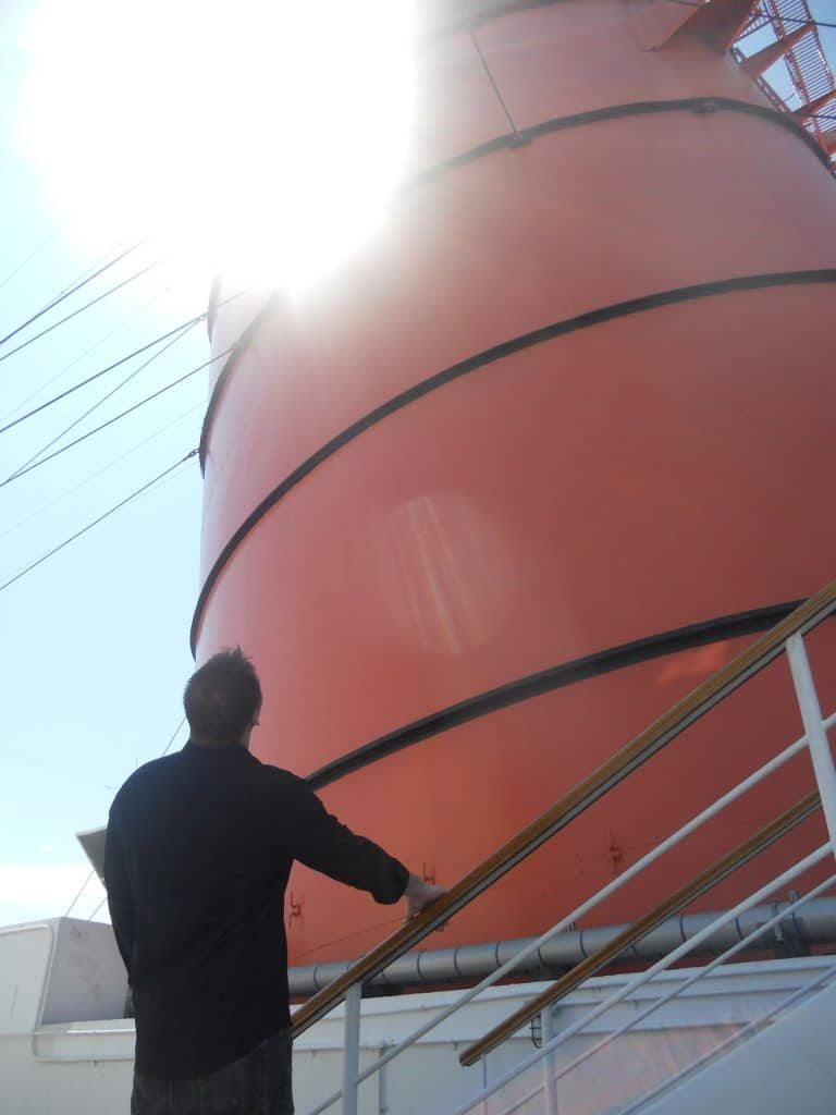 Jason looking at a smoke stack while Exploring the Queen Mary
