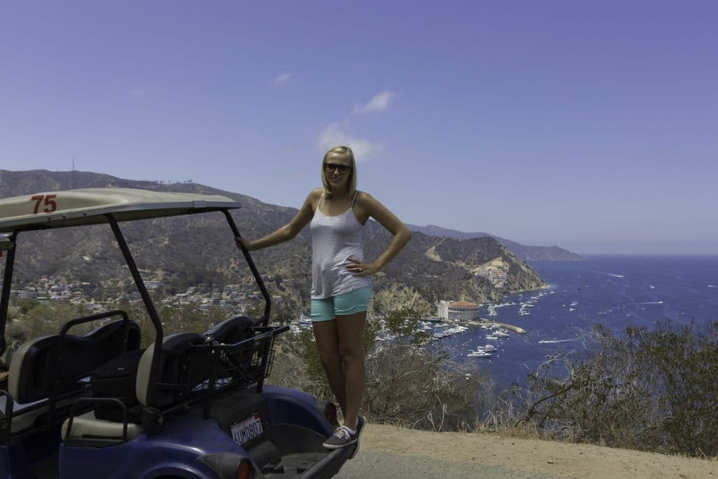 Standing on a golf cart at the top of Avalon - Things to do in Catalina