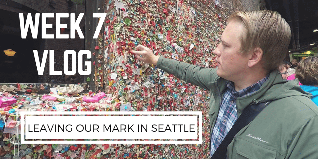 Getaway Couple Jason Miller adding gum to famous seattle gum wall