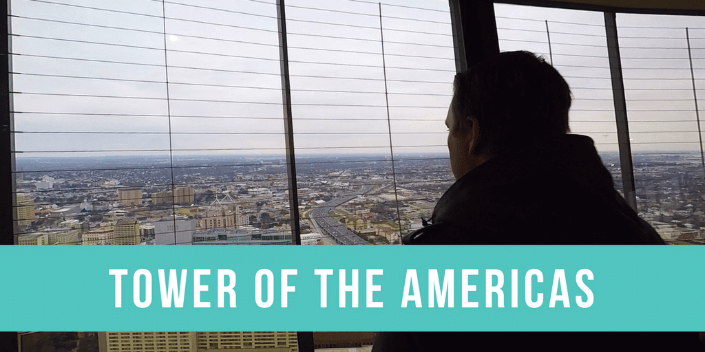 Man looking out of the top of the Tower of the Americas in San Antonio