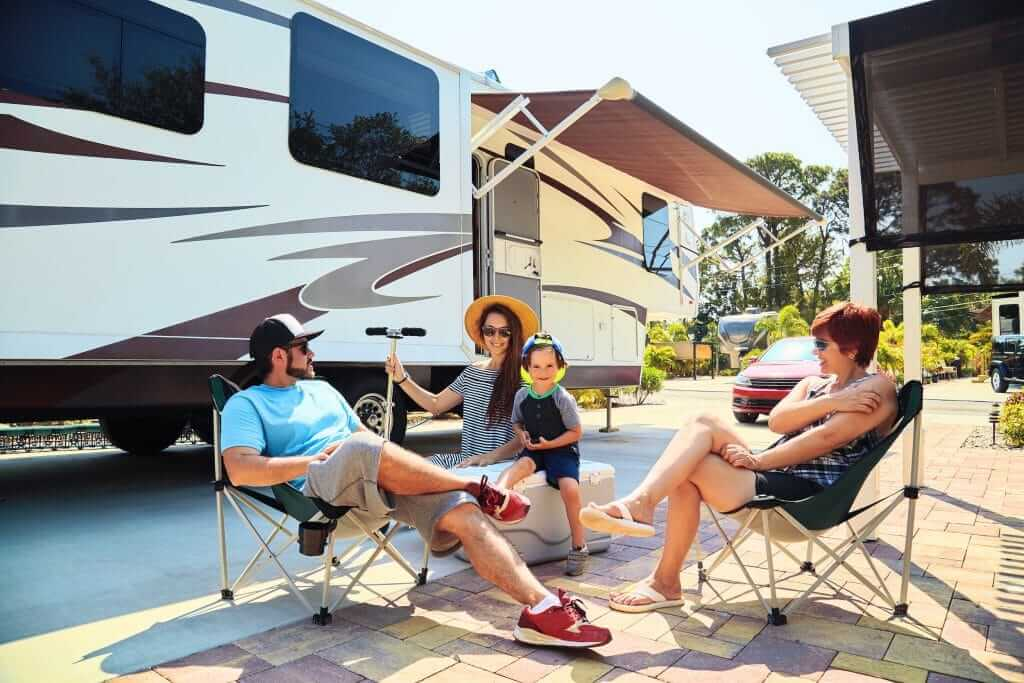 Family sitting at Passport America campground have a good day.