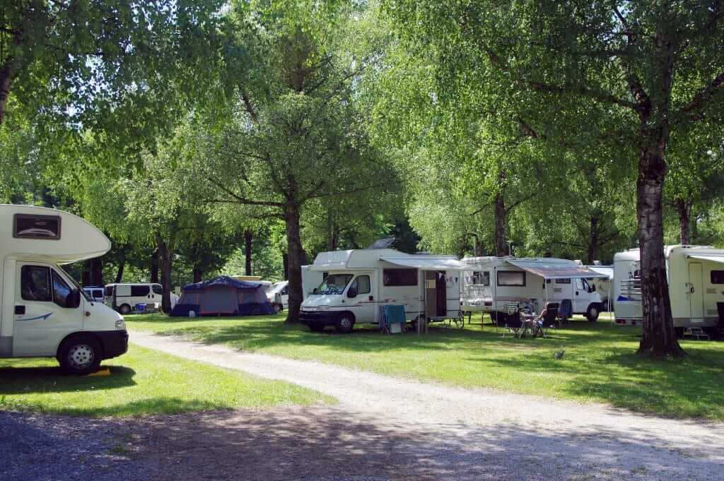 RVs in a campground attached to a dealership