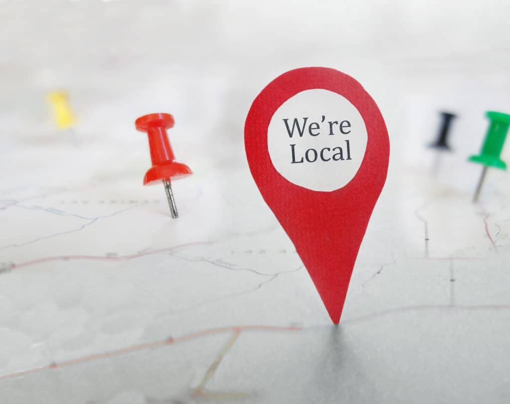"""Map with an indicator that marks a point on the map and says """"We're Local"""""""