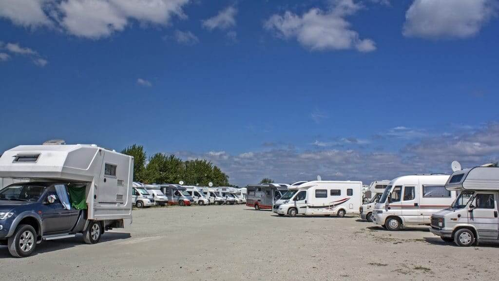Different types of RVs in a campground.