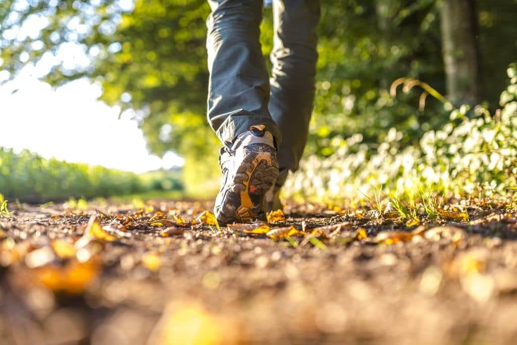 Picture of feet of man on a walk.