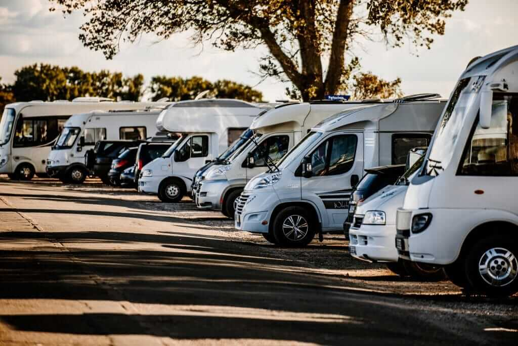 Row of RVs in a campground.