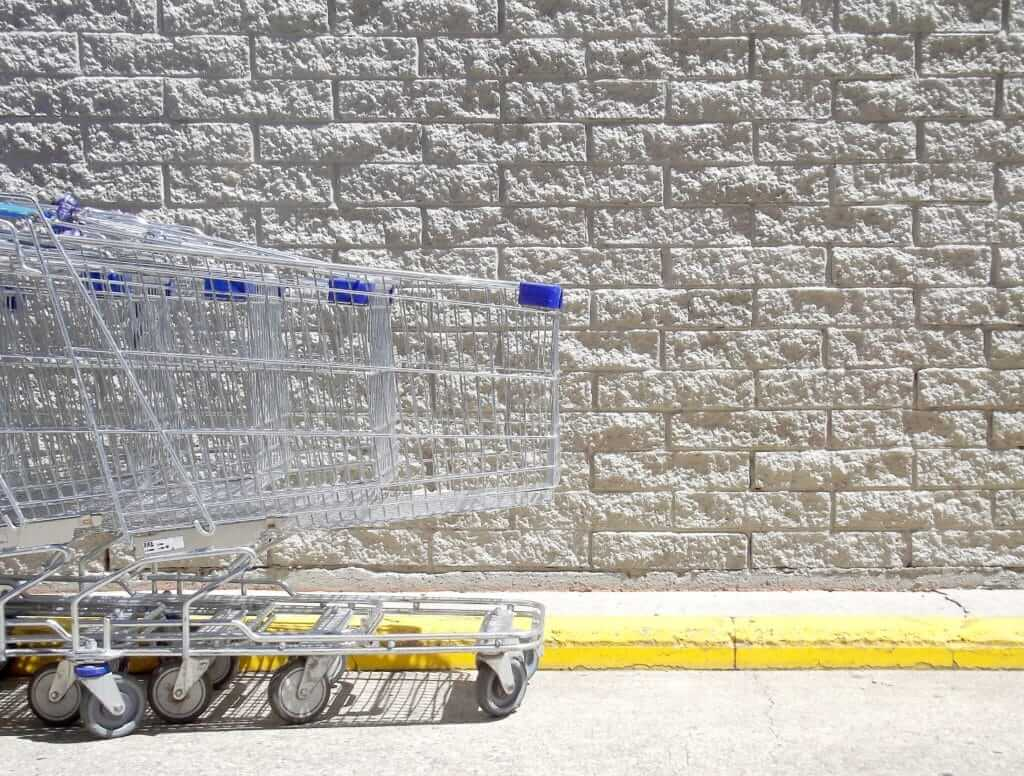 Shopping carts lined up in a Walmart parking lot