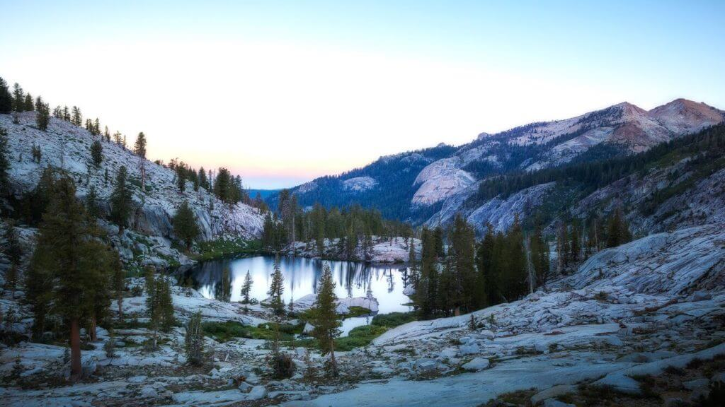 Lake with trees around it at dusk in Sequoia National Park