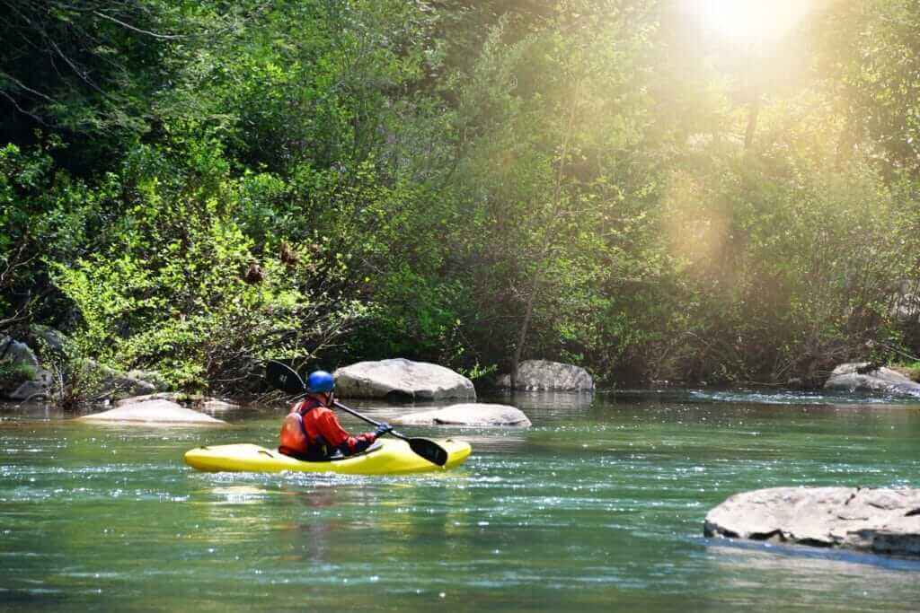 Man in a kayak floating down Smith River