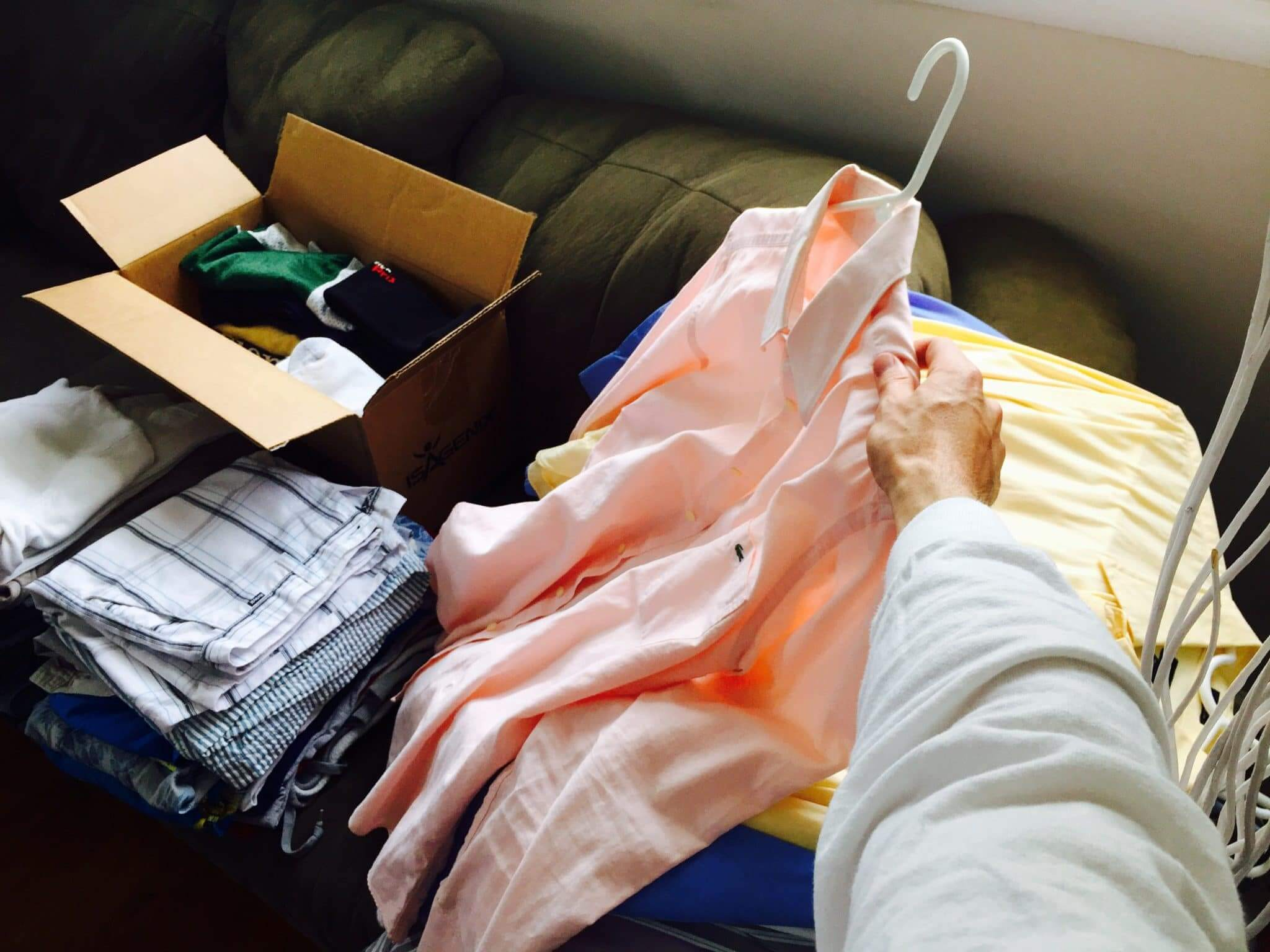 Sorting through clothes to downsize to full-tme RV