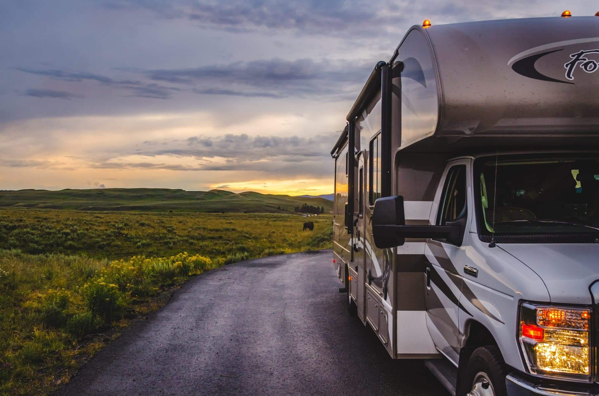 RV in field with sunset in background