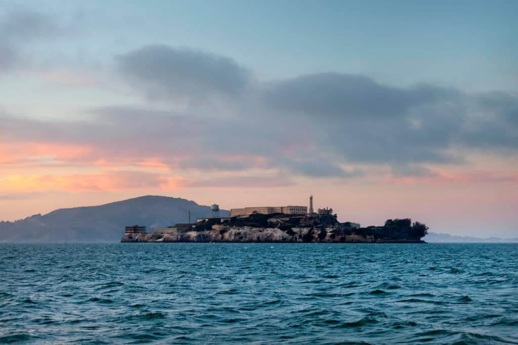 Alcatraz Island, a top thing to do when visiting San Francisco, during sunset