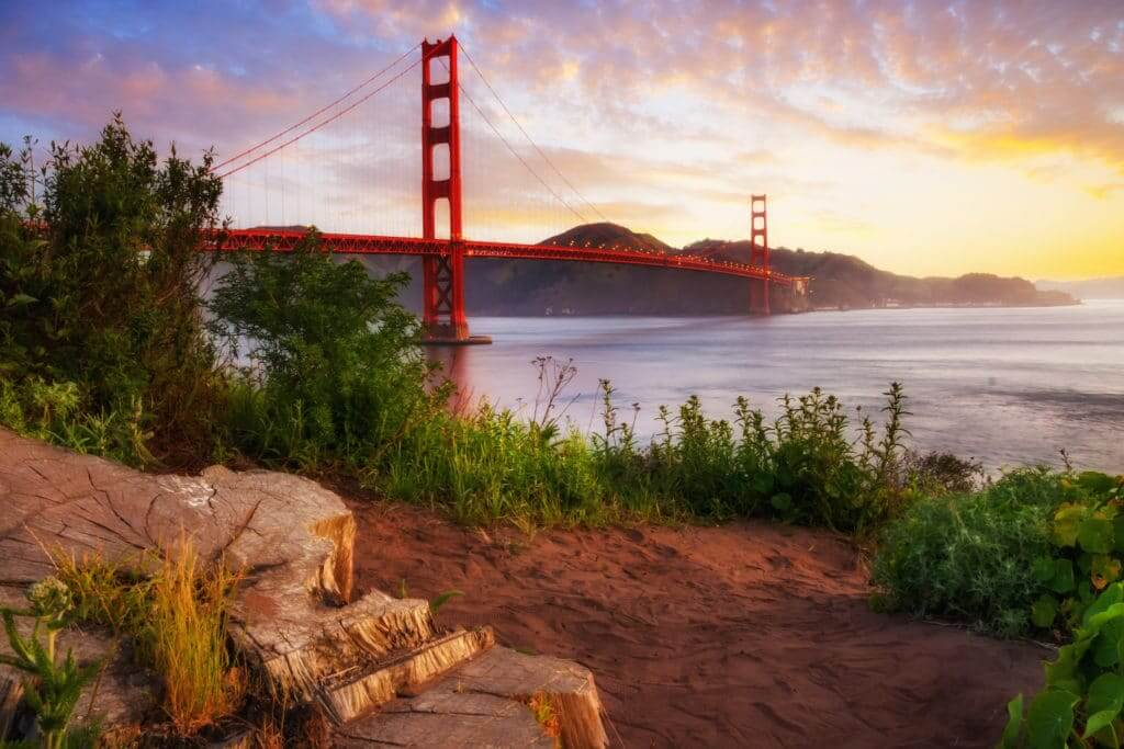 The most well know must-see place in San Francisco, the Golden Gate Bridge, at sunrise.