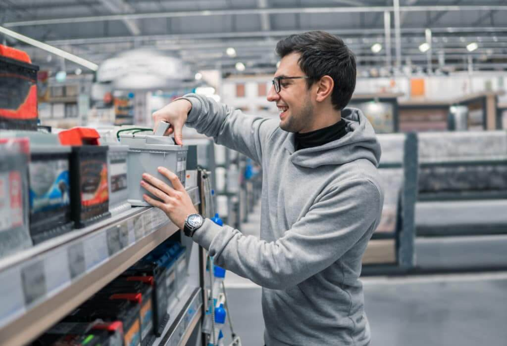 male customer buying the best RV battery