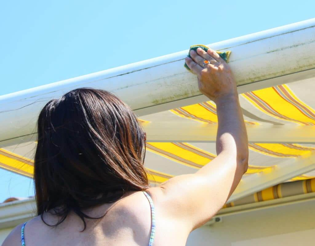 Woman cleaning RV awning