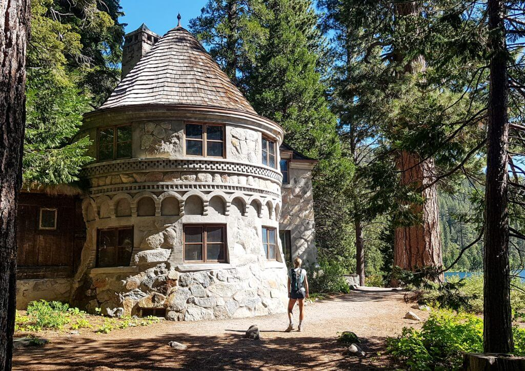 Girl standing in front of Vikingholm castle in Emerald Bay State Park