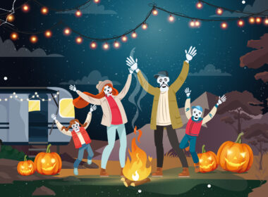 An illustration of a family of skeletons dancing in their campsite