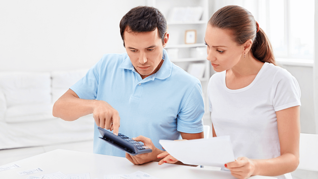 Man and Woman reviewing finances for an RV loan