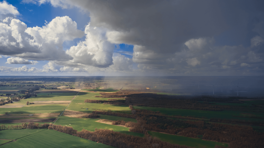 Low pressure weather system moving across farmland
