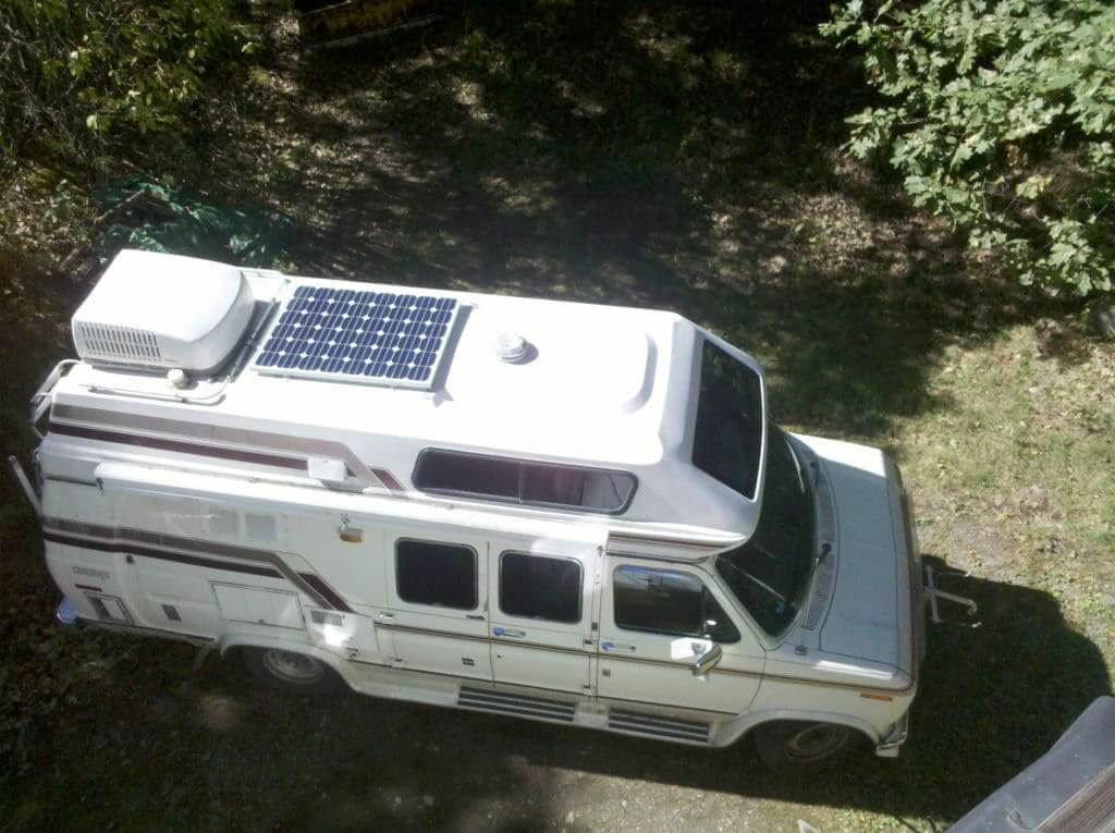 Small RV with one solar panel on the roof