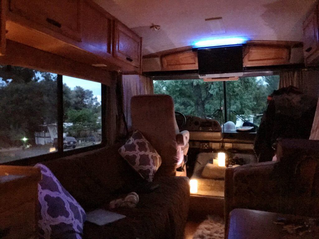 Small motorhome interior with cozy fake candles and pillows