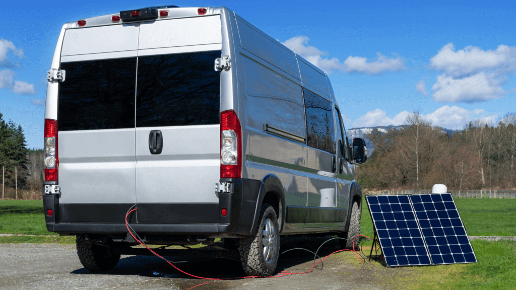 Class B small motorhome parked and charging its battery with solar