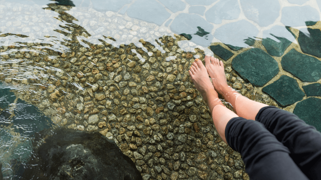 Lady with feet in hot spring water