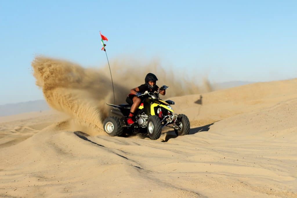 man on atv in pismo dunes