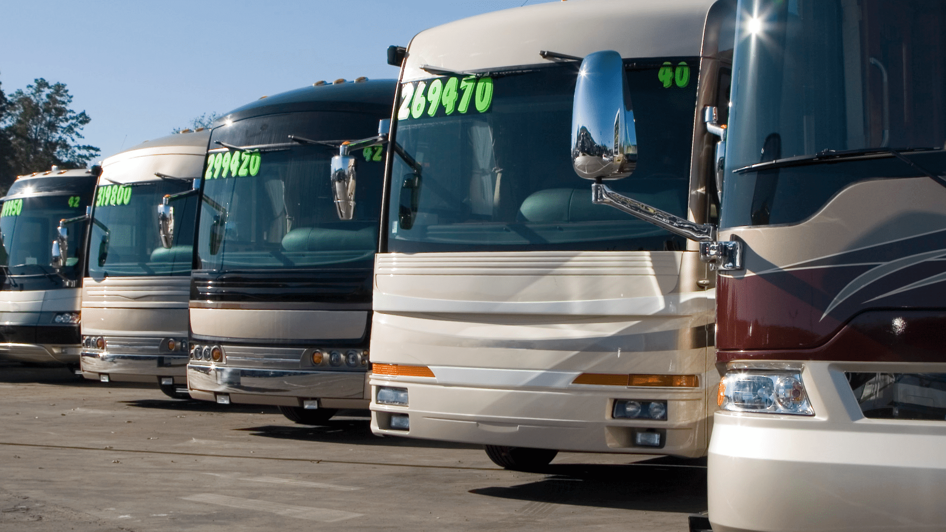 RV prices displayed on window of motorhomes on RV lot