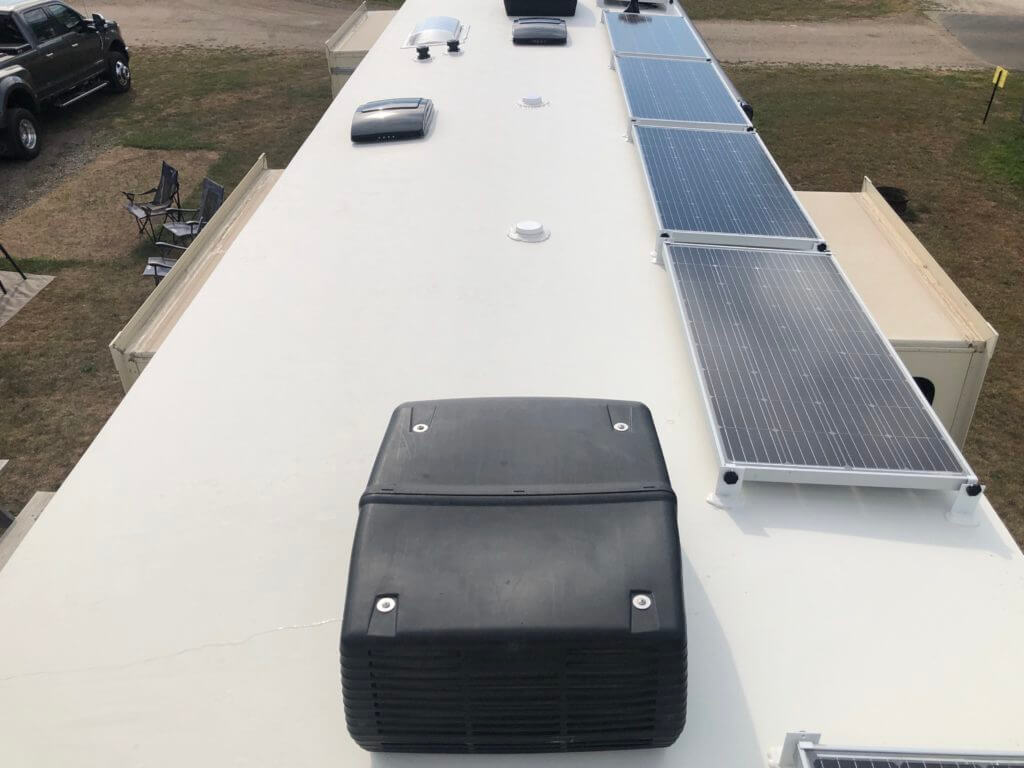 Clean RV roof with solar panels and ACs. Cleaning your roof is part of how to wash your RV.