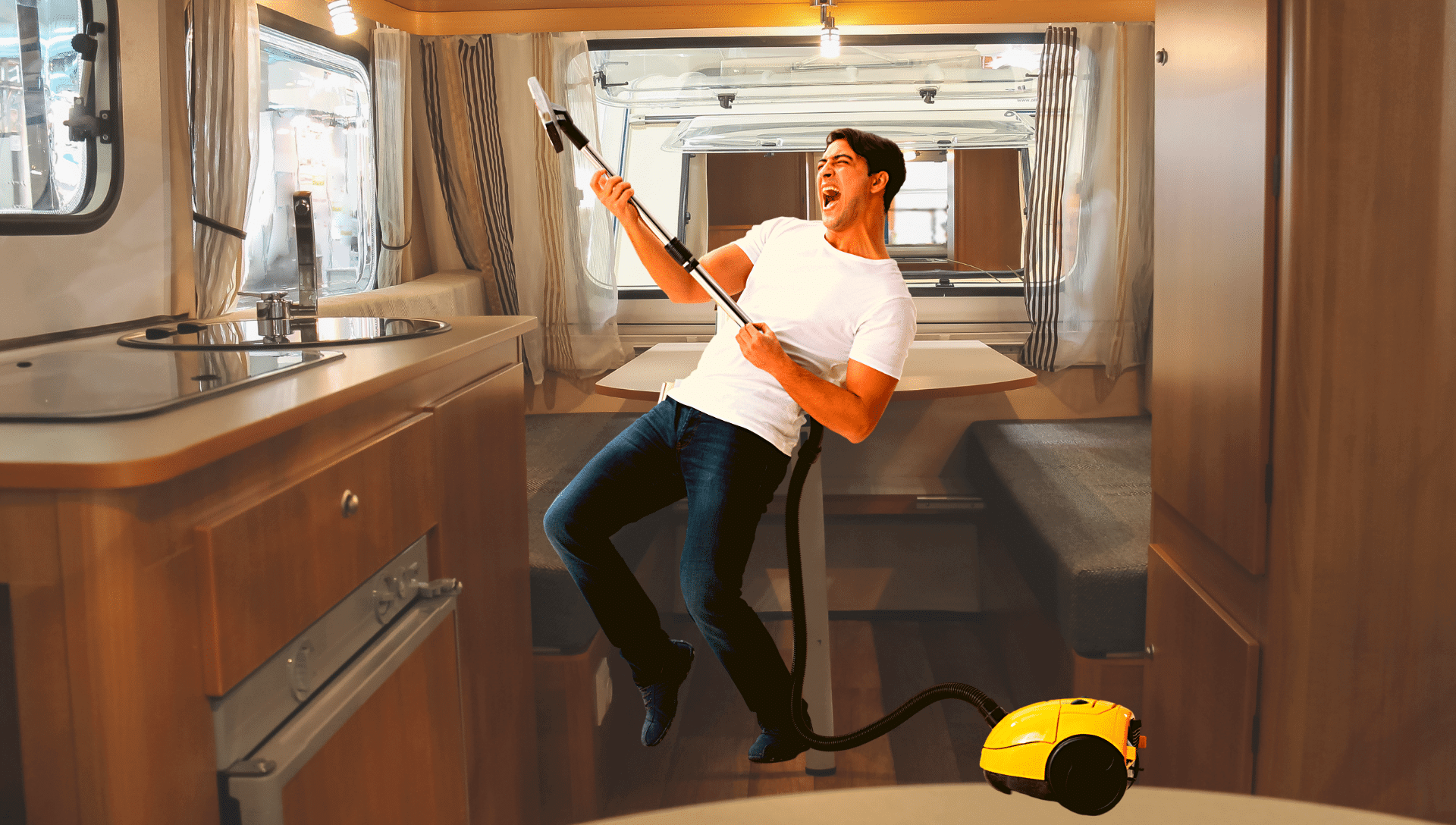 A man is dancing with his vacuum while cleaning the RV interior