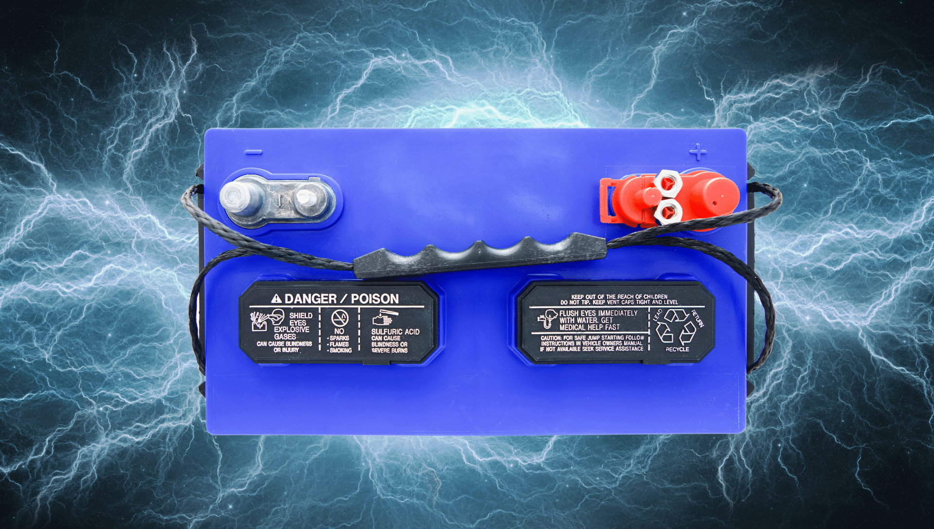 An RV battery is shown from the top view with blue electricity on a black background.