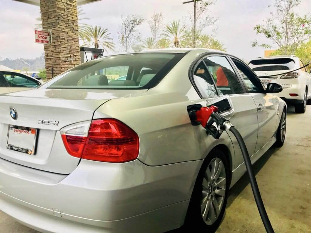 A car filling up at the gas pumps