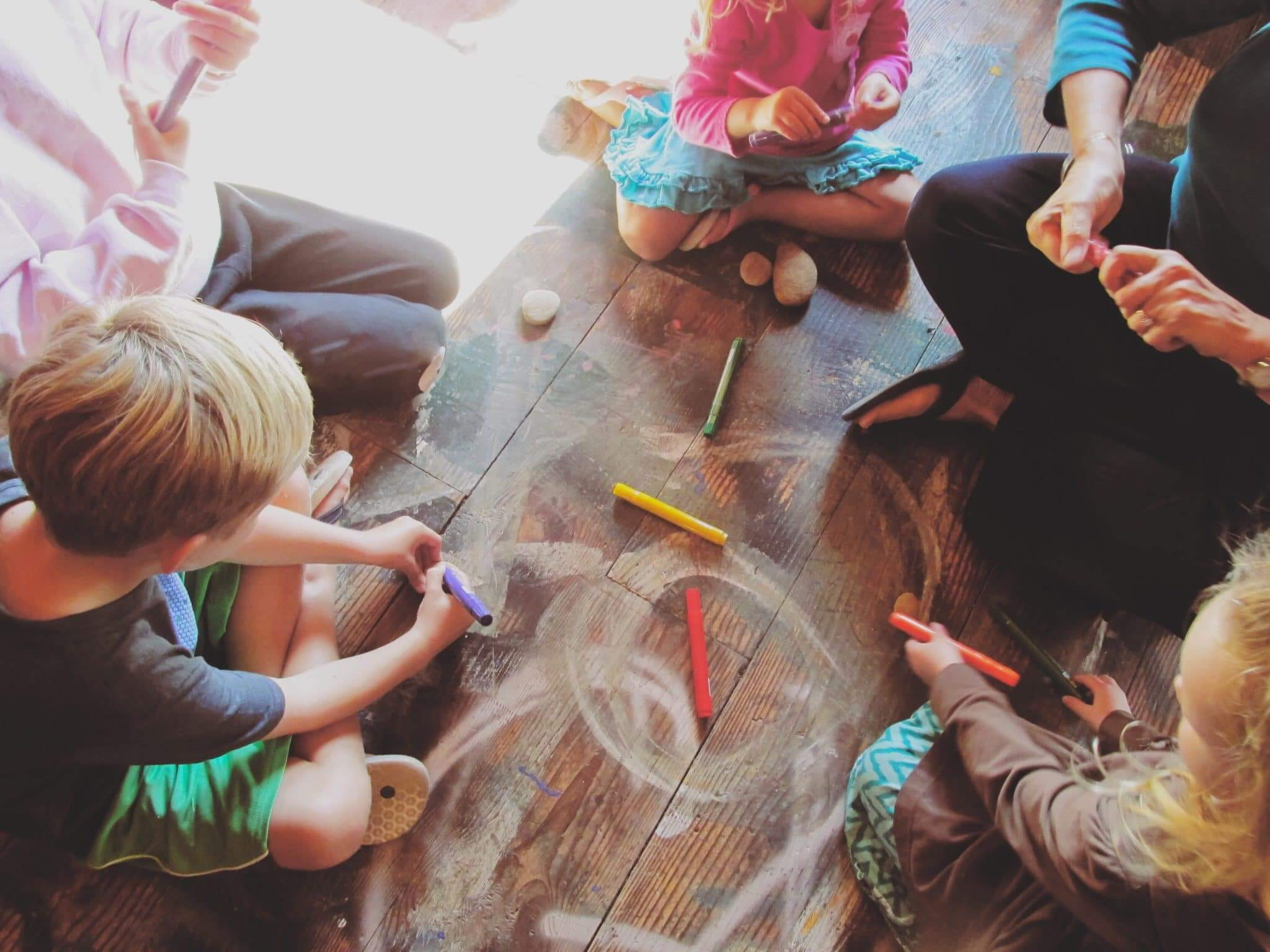 Kids learning about nature while playing with chalk and rocks