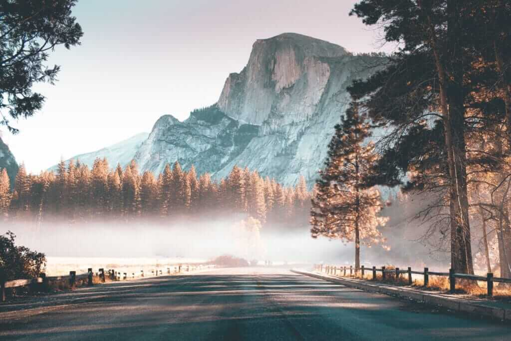 View of half dome with fog beneath it, Yosemite National Park is 5 miles from Thousand Trails Yosemite.