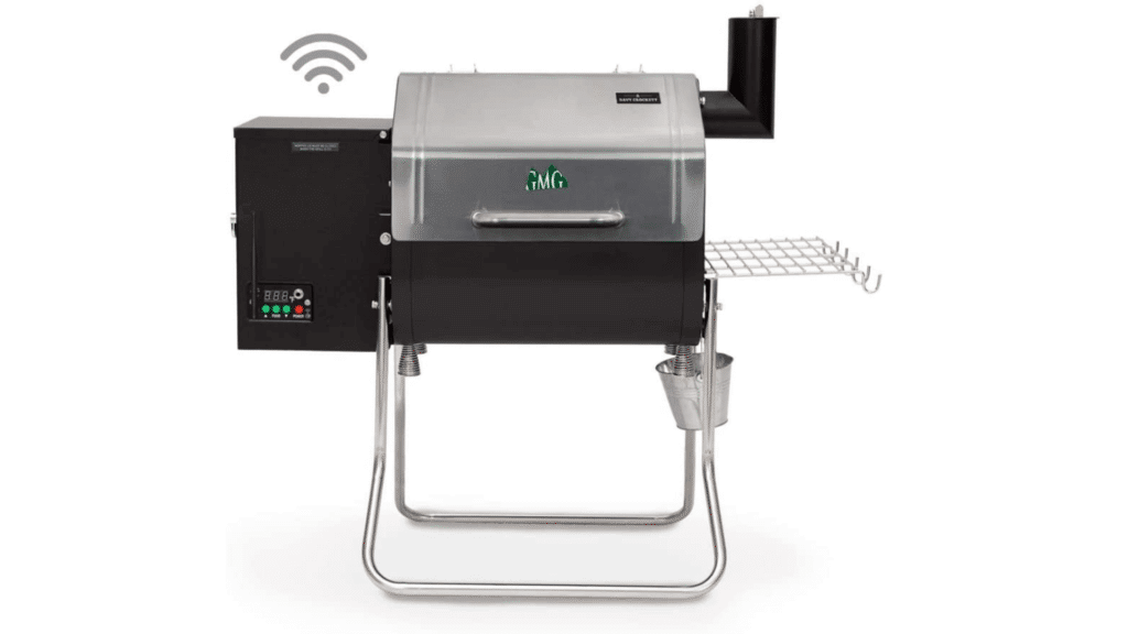 A green mountain grills davy crockett portable smoker against a white backdrop.