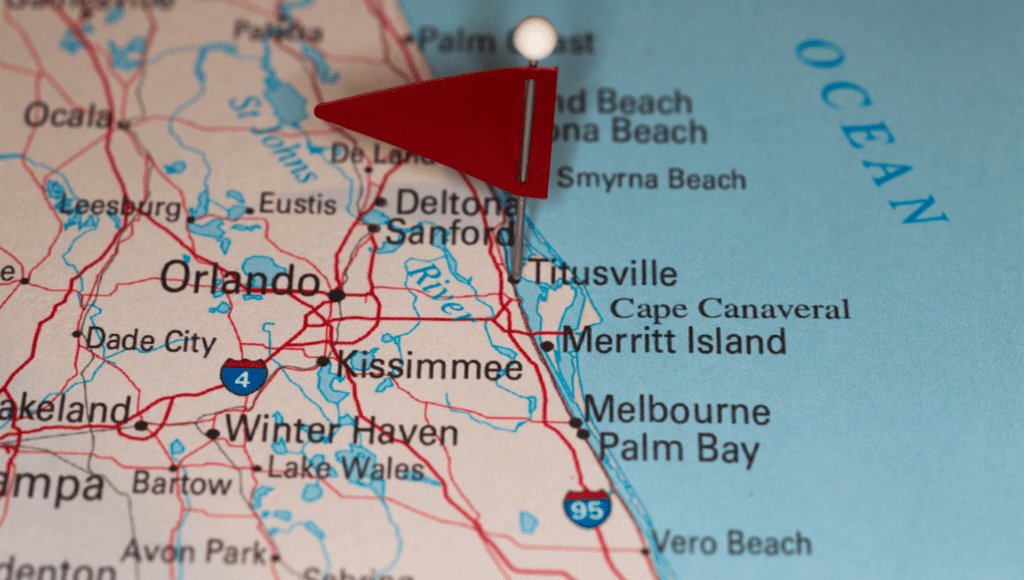 A road map of the eastern portion of Florida with a red flag pin on Titusville which is the location of one of the best good sam campgrounds in Florida.