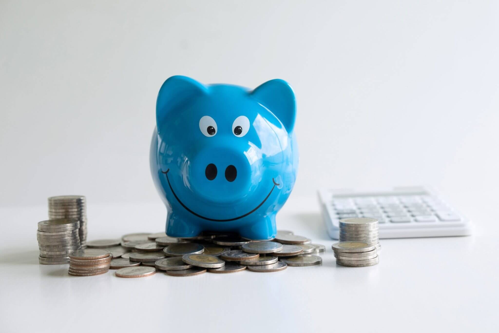 Save Money in a blue piggy bank