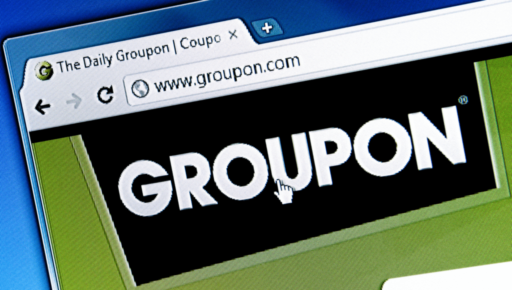 The groupon logo is shown on the screen of a computer.