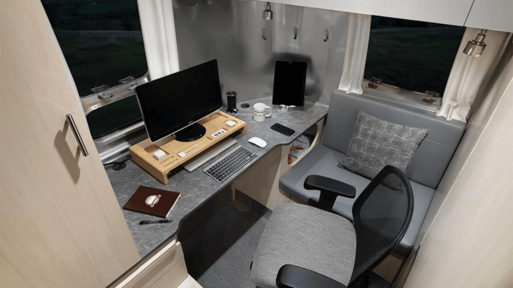 Airstream Flying Cloud 30FB Office RV working office space with computer set up ready to work.