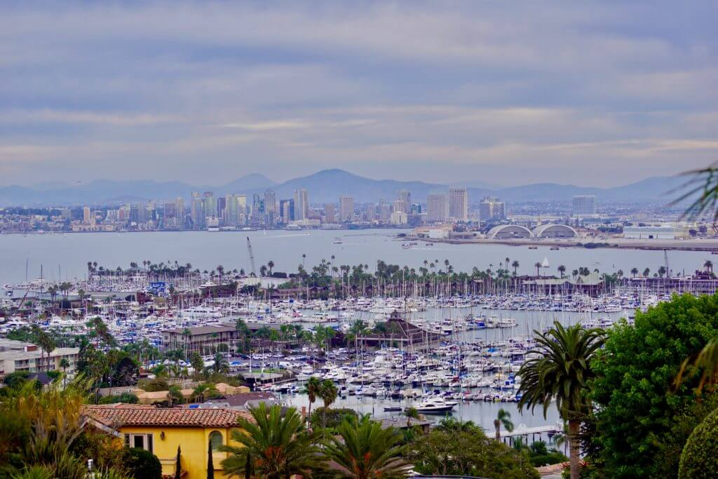 Aerial shot of San Diego in the background and Coronado Island in the foreground.