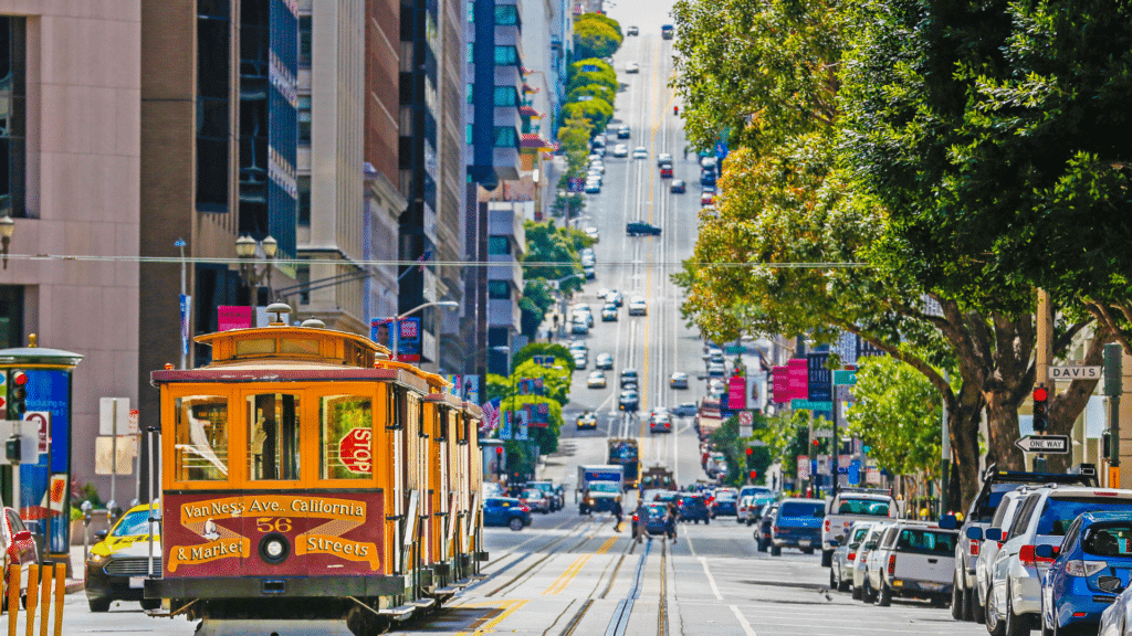 Trolly in San Francisco travels along tenderloin and approaches a famously steep hill.