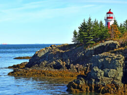 The atlantic ocean surrounds an island and lighthouse that hold the only US National Park in Canada.