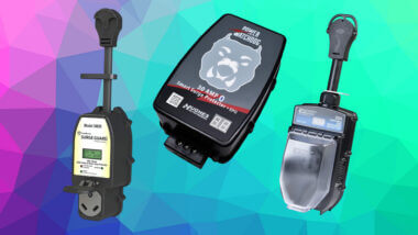 3 of the best RV surge protectors set against a purple, teal, and blue geographic background.
