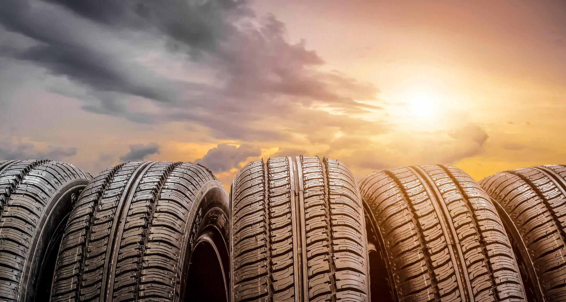 Close up of tires with clouds and the sun in the background. Which are the best RV tires?