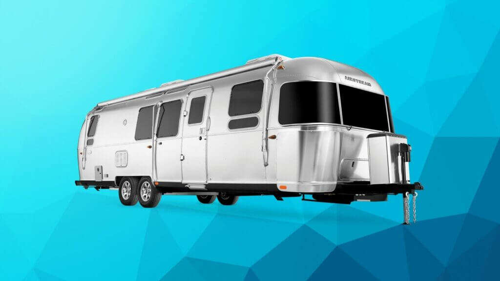 Airstream travel trailer on blue background