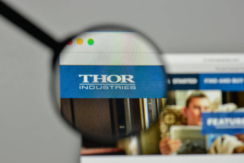 Thor Industries logo on the website homepage with a magnifying glass over the logo, Thor is who makes Heartland RV.