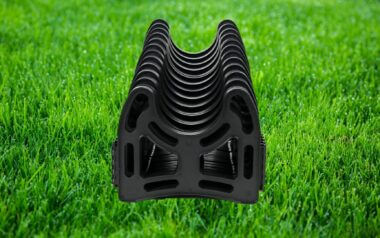 RV sewer hose support sitting on a field of grass