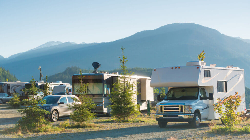 RVs are parked for a long-term stay with beautiful mountains glowing in the background.