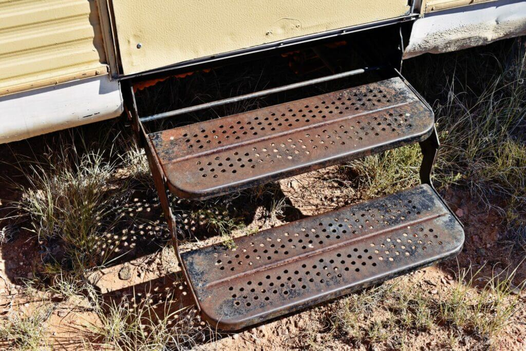 Rusty metal RV steps. This is what happens when you don't have RV step covers.